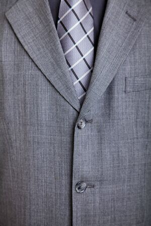 grey suit with checkered tie. Detail. Stock Photo - 6126292
