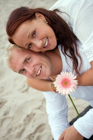 portrait of romantic young couple by the beach photo