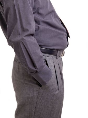 Man with bulging belly and hand in his pockets