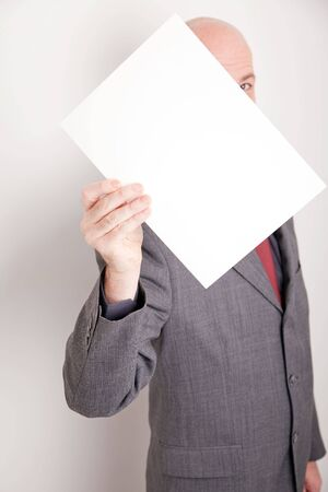 Man wearing suit holding blank paper Stock Photo - 6237080