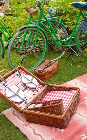 Vintage bikes and picnic basket for a romantic setting photo