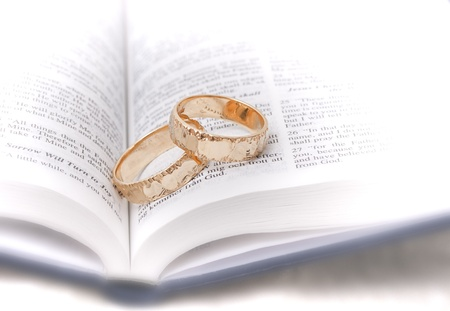 Gold wedding rings on a bible photo