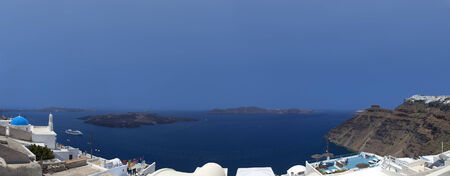 Santorini panorama of the beautiful view of the caldera from the town of Fira   photo