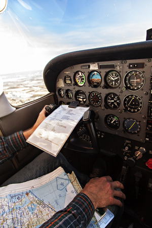 altimeter: Image of the inside of a small plane cockpit   the pilot