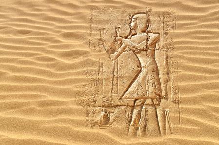 Image of egyptian hieroglyphs hidden under the desert sand Banco de Imagens