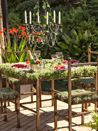 an unusual and pitoresque garden table setting. photo