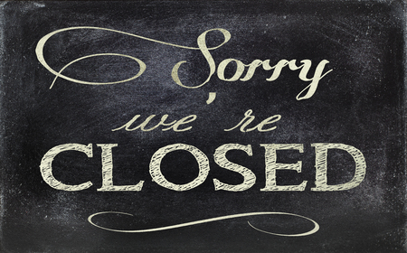 Image of a blackboard sign, stating CLOSED. photo