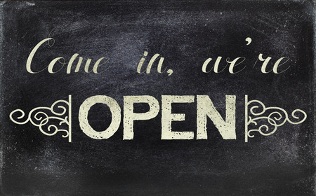 stating: Image of a blackboard sign, stating OPEN.