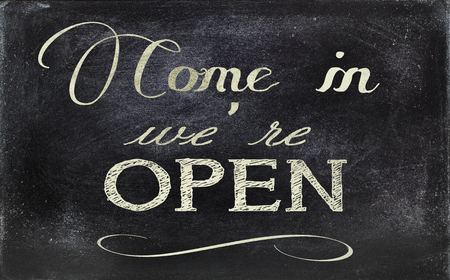 Image of a blackboard sign, stating OPEN. photo