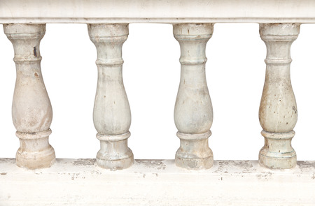 Image of a row of white bannister pillars made of stone. photo