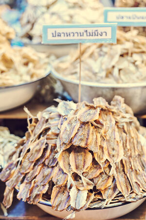Image of a pile of dried fish at thai grocery market. photo