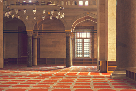 The inside of Suleymaniye mosque bathing in warm light. Istanbul, Turkey.