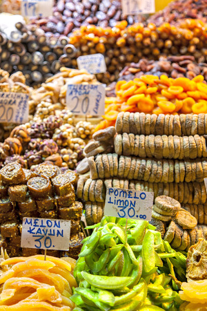Image of market offering a selection of dried fruits and baklava. photo