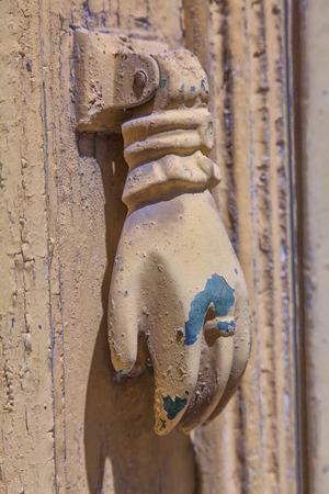 doorknocker: Image of a hand shaped doorknocker. Stock Photo