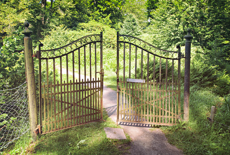 entrances: Image of antique wrought iron gate. Stock Photo