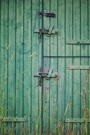 Image of a worn old barn door. Banco de Imagens