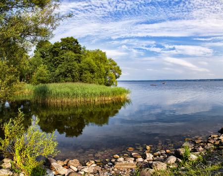 blue summer sky: Image of the lake Ringsjon, in central Scania, Sweden.