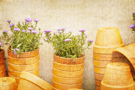 styled: Vintage styled image of stacked plant pots in the garden. Stock Photo