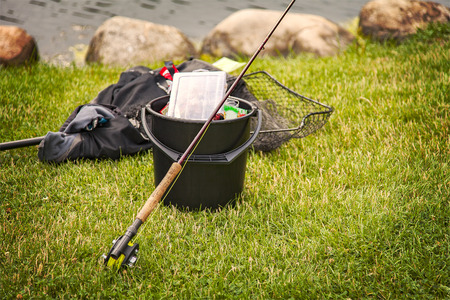 fishing gear: Image of fishing gear on the grassy shore. Stock Photo