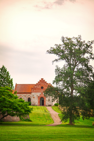 nas: Image of the church of Nas, located on the grounds of the castle of Trollenas. Scania, Sweden.