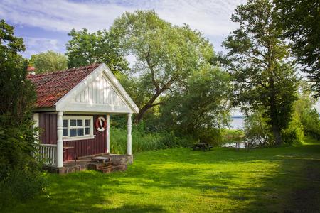 Image of a quiant red summer cottage. Rural Sweden.