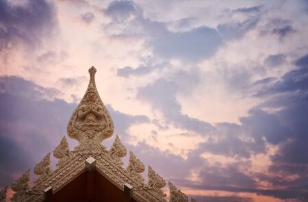 buddhist temple roof: Detail of the roof of a buddhist temple with dramatic sunset sky. Thailand.