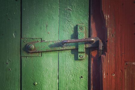 clasp: Image of an old barn door with iron clasp. Stock Photo