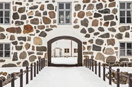 gatehouse: Image of castle gatehouse, and moatbridge. Hovdala, Hassleholm, Sweden.