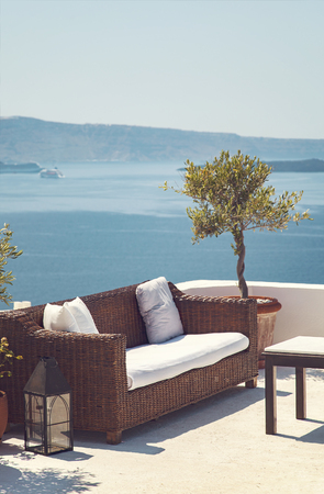 patio chairs: Image of a romantic patio with sea view. Samtorini, Greece.