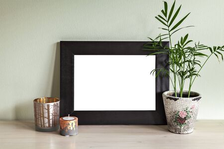 candle holder: Image of frame mockup scene with plant and candle holders.