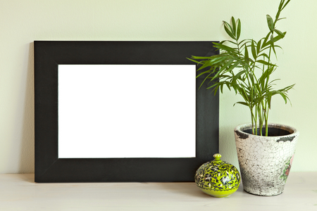Image of a wooden frame mockup scene, on green wall. Stok Fotoğraf
