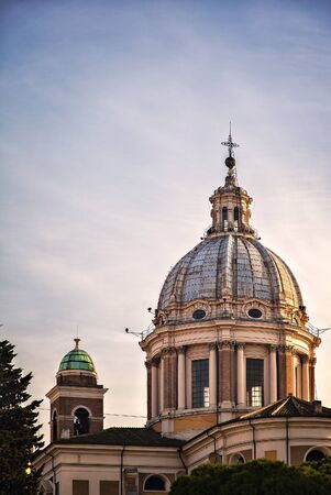 cupolas: Image of one of many ornate church cupolas in Rome, Italy.