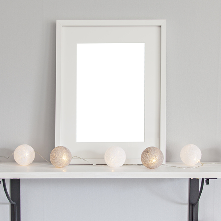 Image of a mockup scene with rectanglurar white frame, and baubles. Stok Fotoğraf