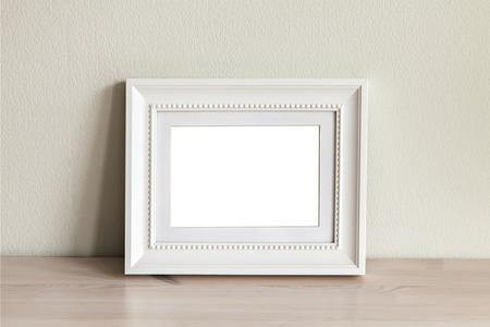 Image of an ornate white frame mockup scene.