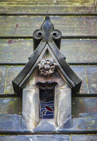 small roof: Image of a small roof window with stained glass. Edinburgh cathedral, Scotland.