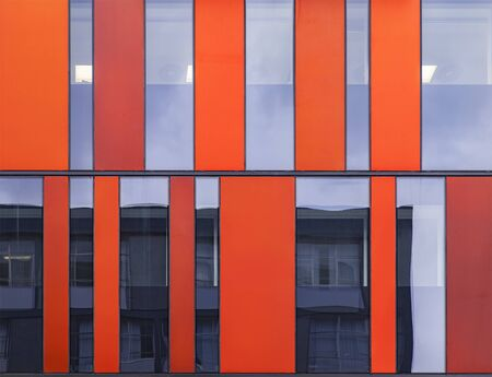fronts: Image of symmetrical modern architecture with glass fronts.