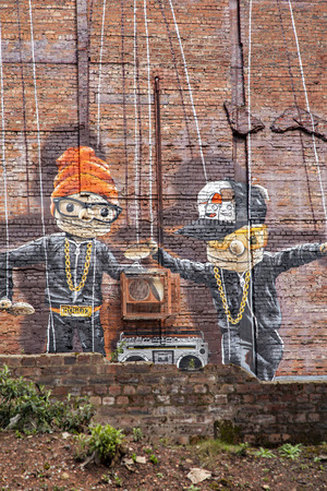 urban culture: GLASGOW APRIL 02, 2016; Wall mural by artist Rogue One called Hip Hop Marionettes. Glasgow, Scotland. Editorial