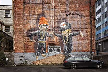 wall mural: GLASGOW APRIL 02, 2016; Wall mural by artist Rogue One called Hip Hop Marionettes. Glasgow, Scotland. Editorial