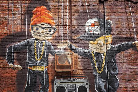 GLASGOW APRIL 02, 2016; Wall mural by artist Rogue One called Hip Hop Marionettes. Glasgow, Scotland. Editöryel