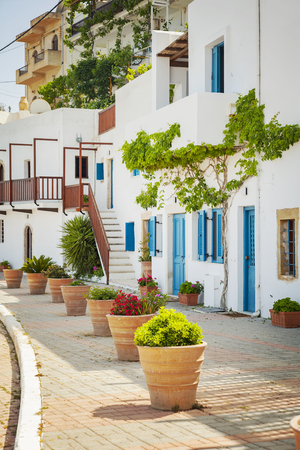 white washed: Image of a typical Greek street with white washed houses. Makrigialos, Crete. Stock Photo
