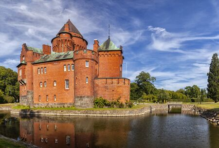 mediaval: Image of Hjularod red brick castle in Sweden, built in a french medieval romantic style.