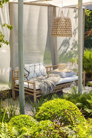 seating area: Image of bamboo garden furniture. Stock Photo
