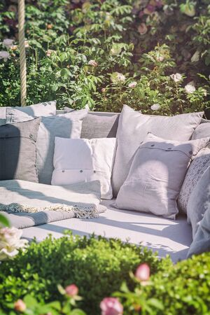 seating area: Image of cozy garden seating area with cushions. Stock Photo