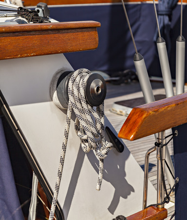 winch: Image of a boat winch with rope.
