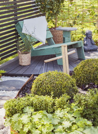 seating area: Image of a tranquil garden seating area.