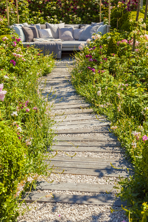 seating area: Garden path leading to comfy seating area. Stock Photo