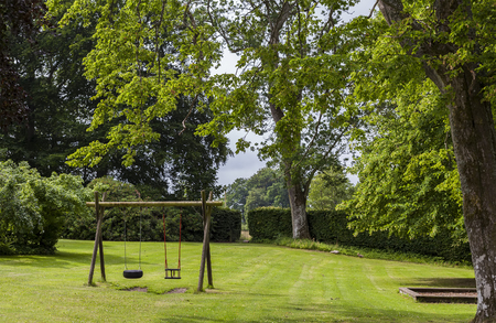 chain swing ride: Image of childrens swingset in green park.