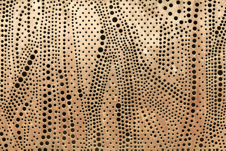 perforated: Perforated metal sheet abstract background.