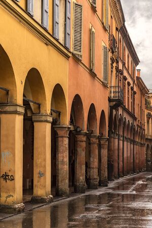 Image of covered porticos with arches in Bologna, Italy.