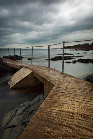 Concrete jetty on stormy day. Arild, Sweden.